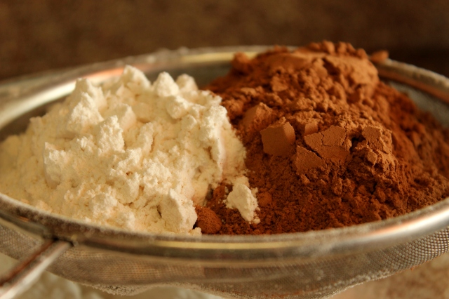sifting flour and cocoa powder for chocolate beetroot cake